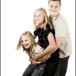 Family Portrait Photography - Three kids hugging smiling and laughing