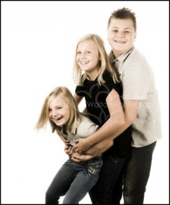 Three kids hugging smiling and laughing - Family & Portrait Photographer