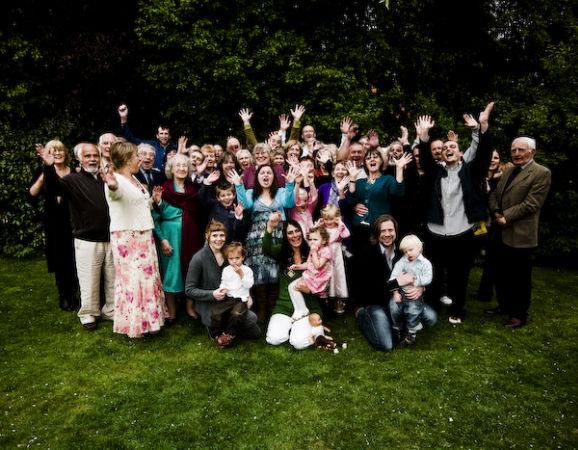 Family group posing for event photographer from Burnham, Slough