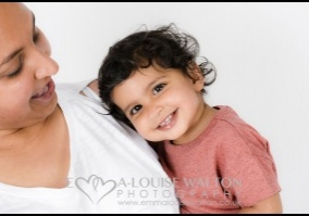 Mother looking at her smiling child taken by a family portrait photography studio in Burnham