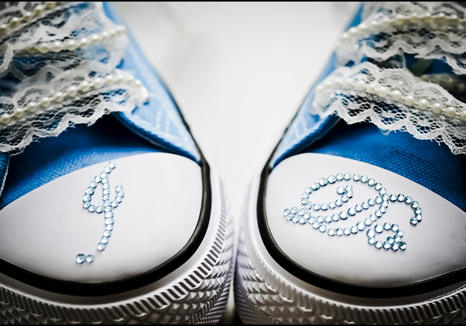 "Blue wedding shoes with rhinestone ""I Do"" photographed in detail by wedding photographer in Burnham, Slough"