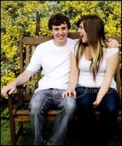 Young Adults laughing on a garden bench - Family Portrait Photographer