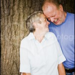 Couple laughing against a tree for portrait photographer from Burnham, Slough