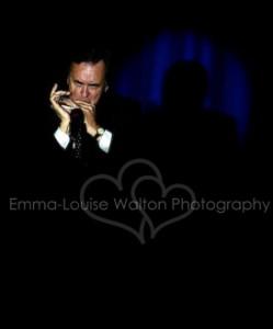 Harmonica Player on Theatre stage - Event and Music Artist Headshot Portfolio Photographer