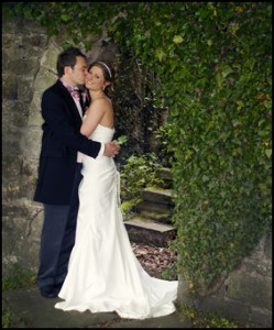 Bride and Groom in a stone archway - Wedding Photographer