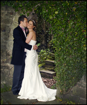 Wedding Photography Bride and Groom in a stone archway