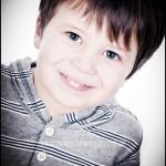 Smiling boy taken at a portrait photography studio in Burnham