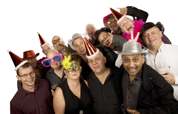 Large photobooth group shot of 14 adults all wearing a variety of photobooth props