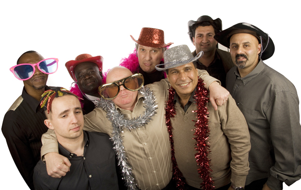 Group of men posing for a photobooth shot, some smiling and some pulling faces. Wearing photobooth props including sparkly cowboy hats, oversized sunglasses and tinsel boas