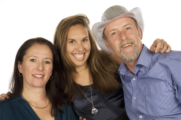 Three adults posing for a photo. Two ladies and a man. The man is wearing one of our photobooth hire props - a silver sparkly cowboy hat