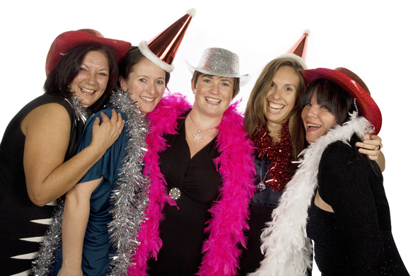 Group photobooth hire shot of 5 ladies wearing a variety of tinsel or feather boas and party hats.