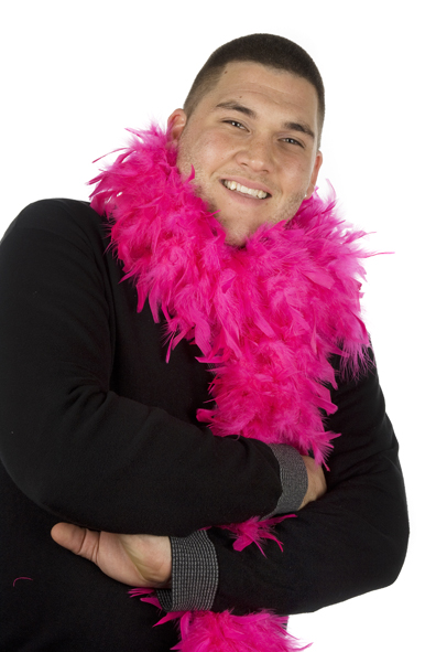 Photobooth posing headshot of a man wearing a black top with grey cuffs and a pink feather boa