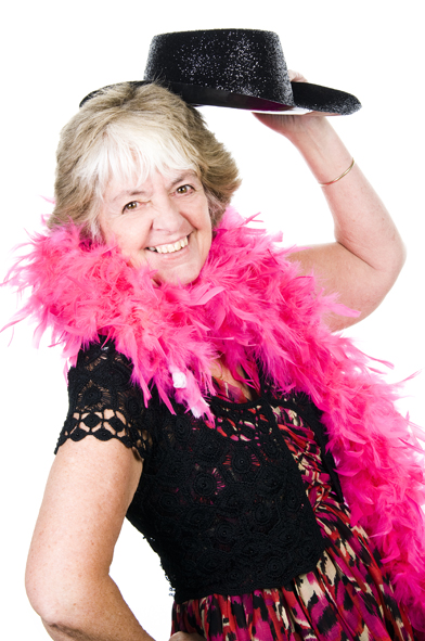 A lady posing for a photobooth hire in burnham, holding a black sparkly cowboy hat and a pink feather boa
