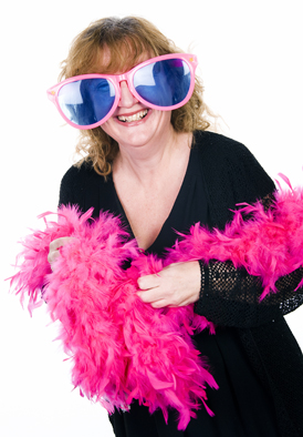 A lady posing for a photobooth hire in burnham, wearing oversized sunglasses and a pink feather boa