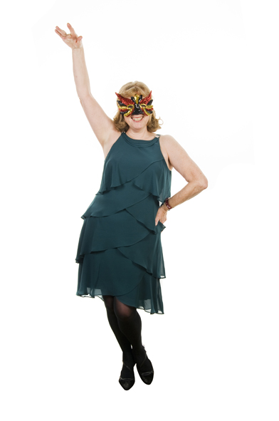 Solo lady posing with a colourful mask wearing a green dress